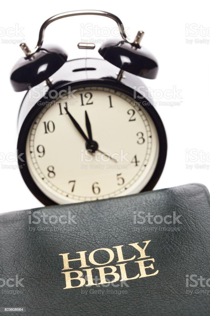 Clock and Bible stock photo