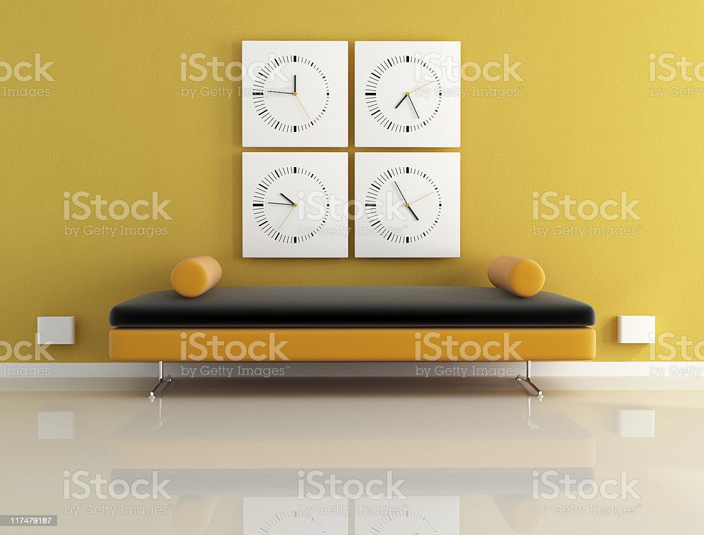 clock and orange sofa royalty-free stock photo