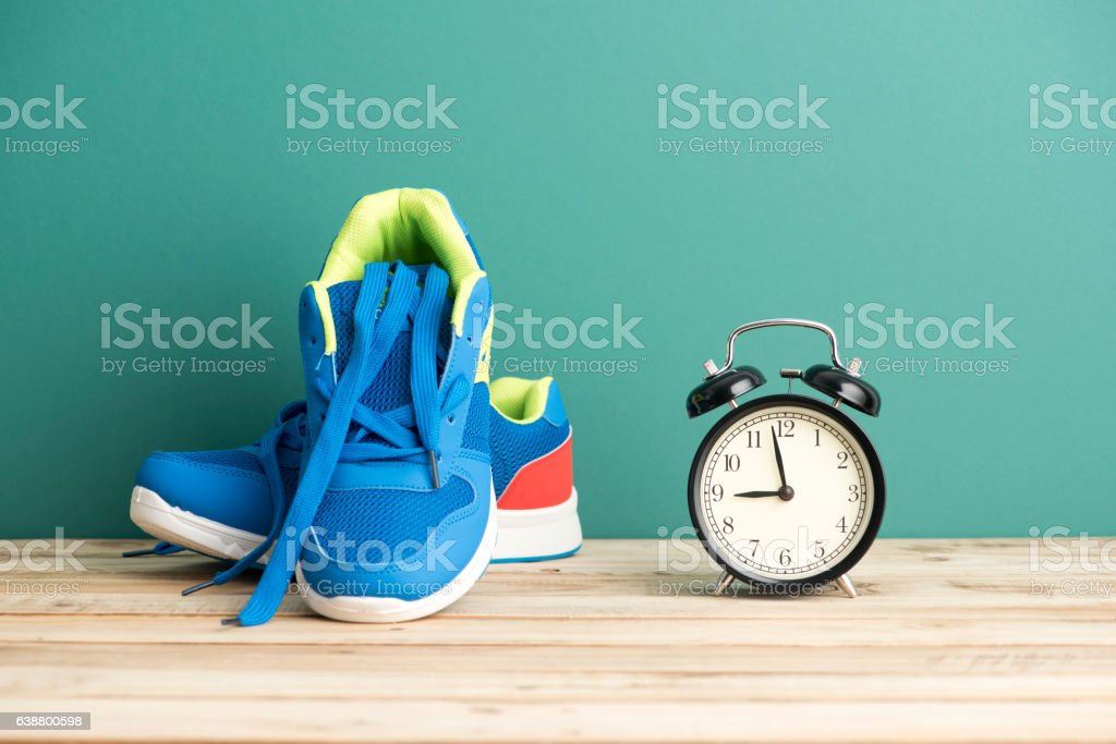 Clock and Sneakers - Fitness Concept stock photo