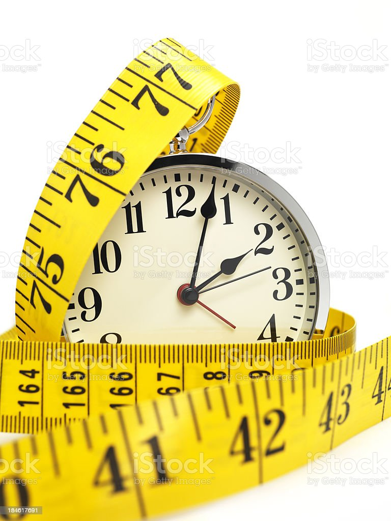 clock and tape measure royalty-free stock photo