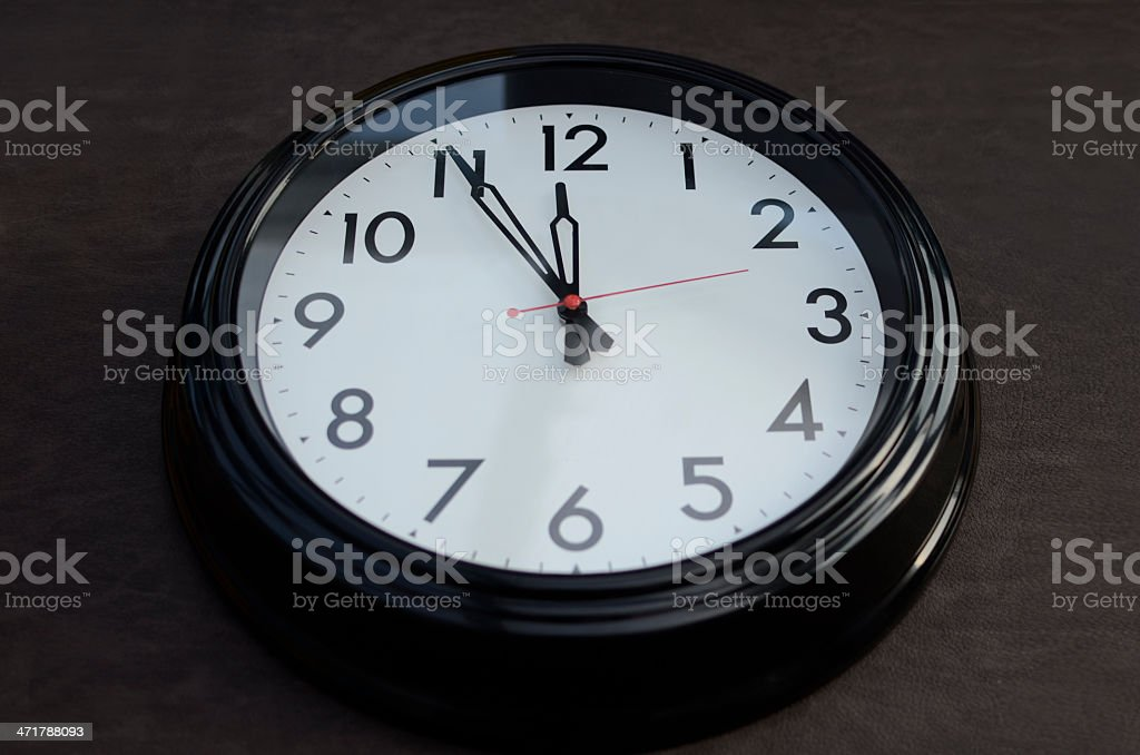Clock at 5 to 12 stock photo