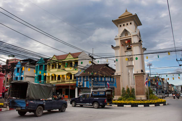 Clock bell tower roundabout of Betong in Yala, Thailand Thai people and foreign travelers drive car and ride motorcycle and bike bicycle at traffic road Clock bell tower roundabout of Betong on August 16, 2019 in Yala, Thailand yala stock pictures, royalty-free photos & images