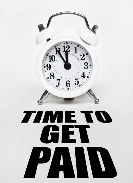 TIME TO GET PAID / Clock concept (Click for more) stock photo