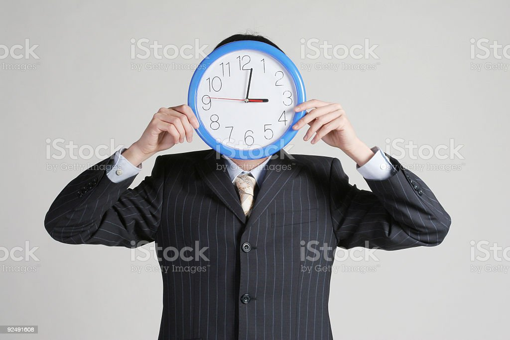 Clock cover businessman's face royalty-free stock photo