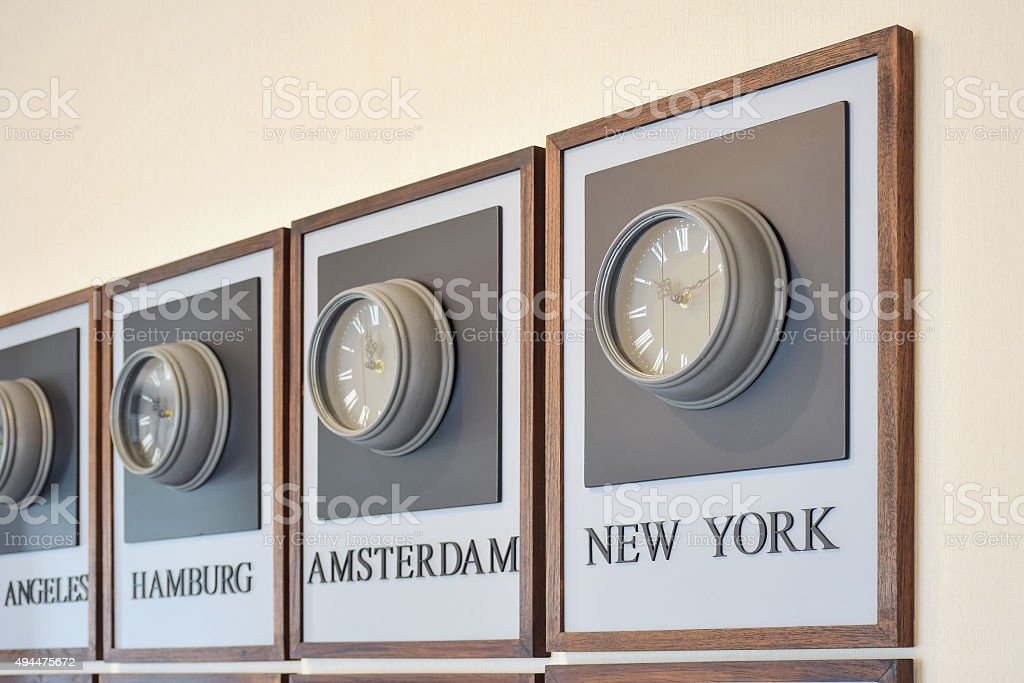 clock different time zones on the wall stock photo