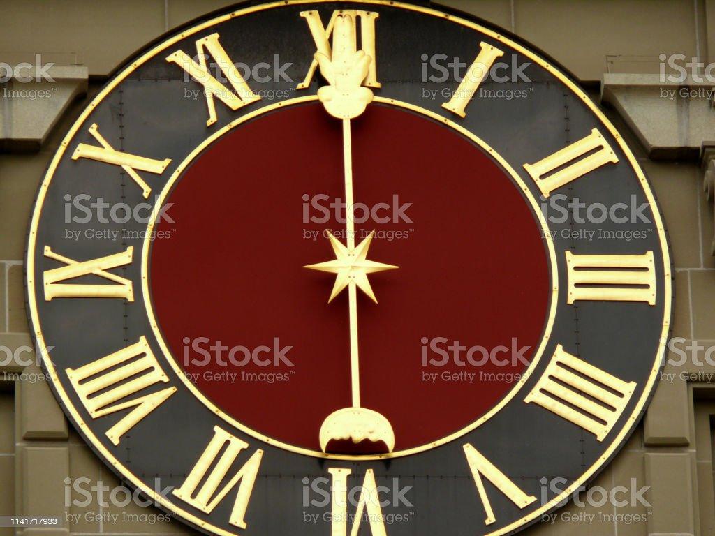 Bern, Switzerland. An original clock placed on the facade of a...
