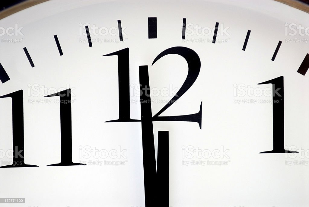 A clock face showing almost 12. stock photo