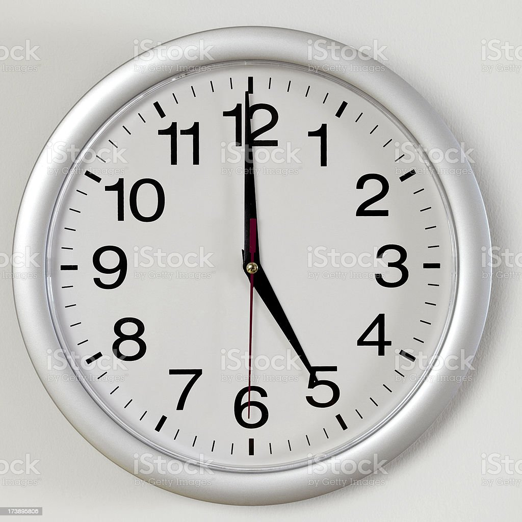 Clock face showing five o'clock royalty-free stock photo