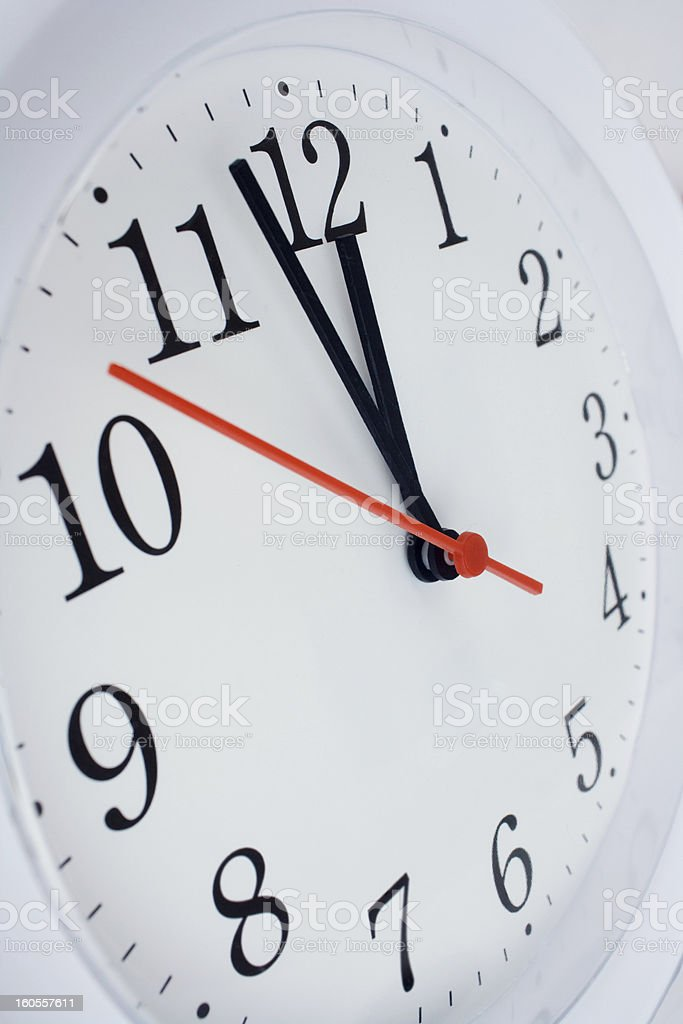 clock face showing nearly twelve royalty-free stock photo