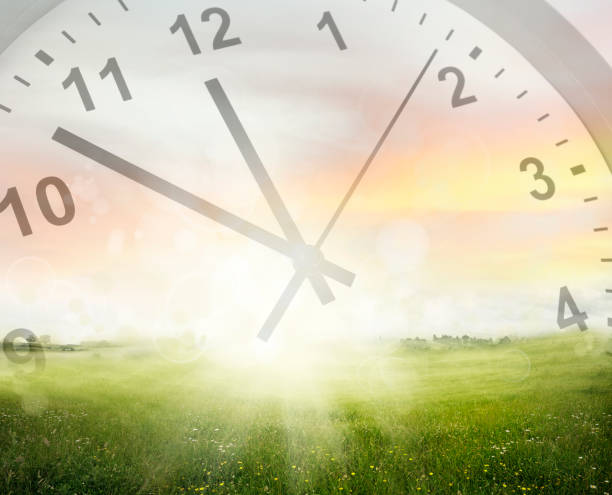 Clock in sky Clock face in sky above field daylight savings stock pictures, royalty-free photos & images