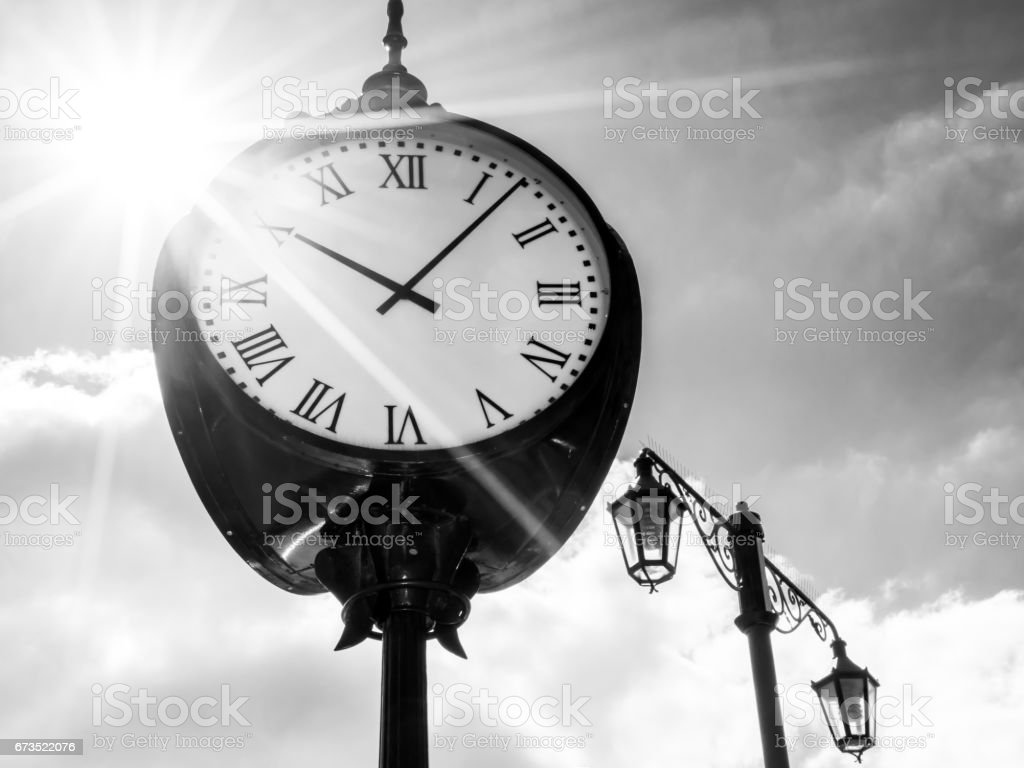 Clock in sunshine, bw stock photo