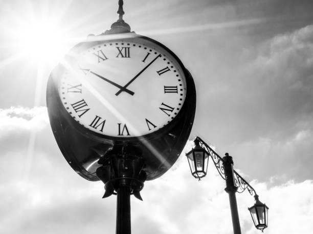 Clock in sunshine, bw stock photo