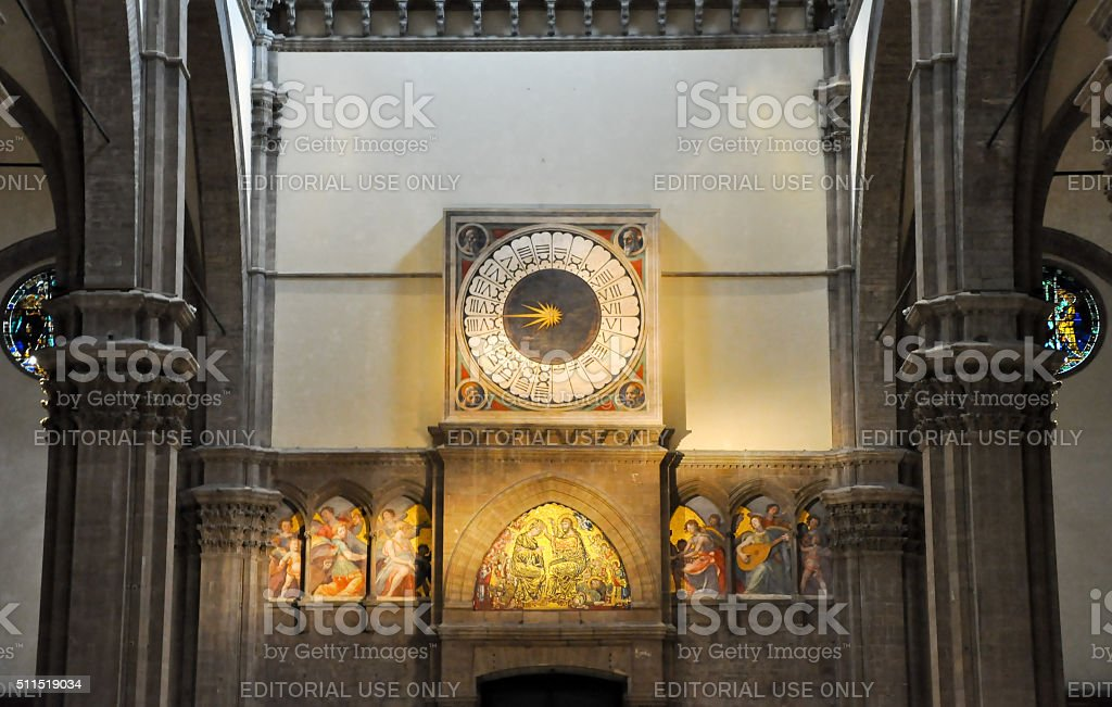 Clock in the Duomo by Paolo Uccello in Florence, Italy. stock photo