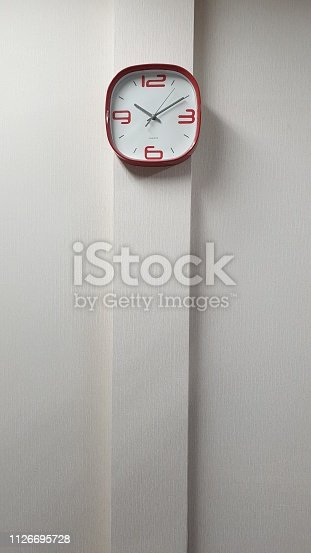 671883446 istock photo clock in the room parallel to the minimalist wall 1126695728