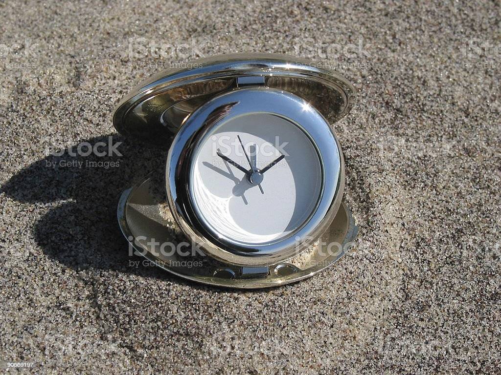 Clock in the sand royalty-free stock photo