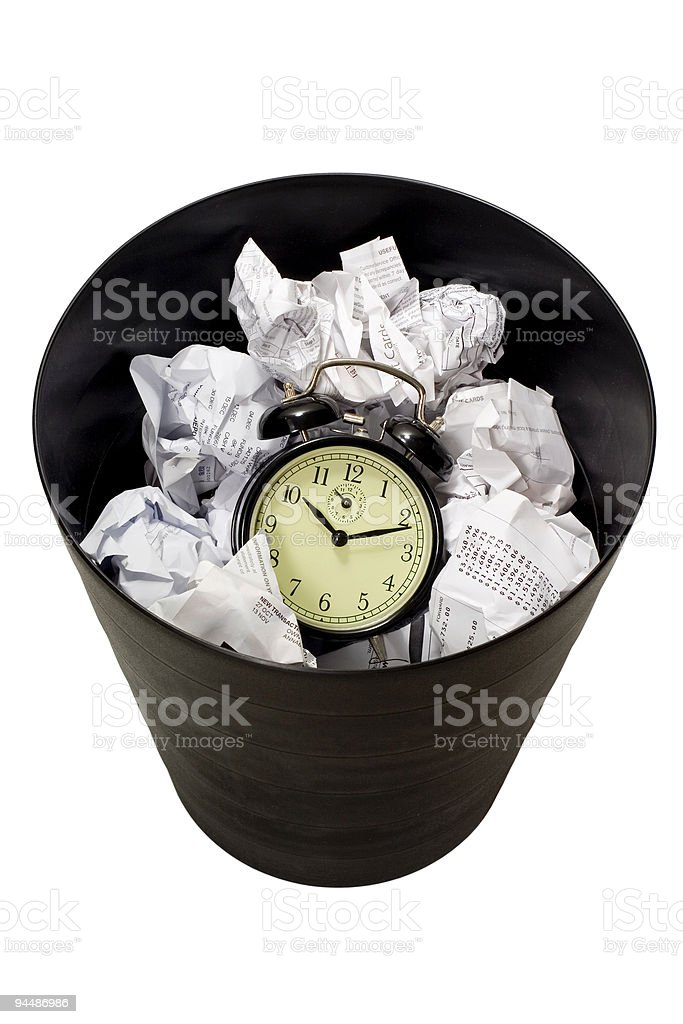 Clock in waste paper basket stock photo