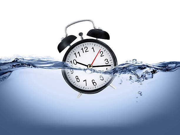 Clock in water stock photo