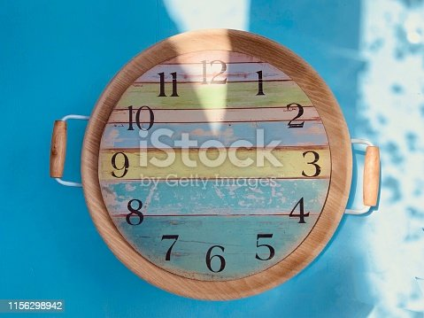 Clock inside a tray on blue background