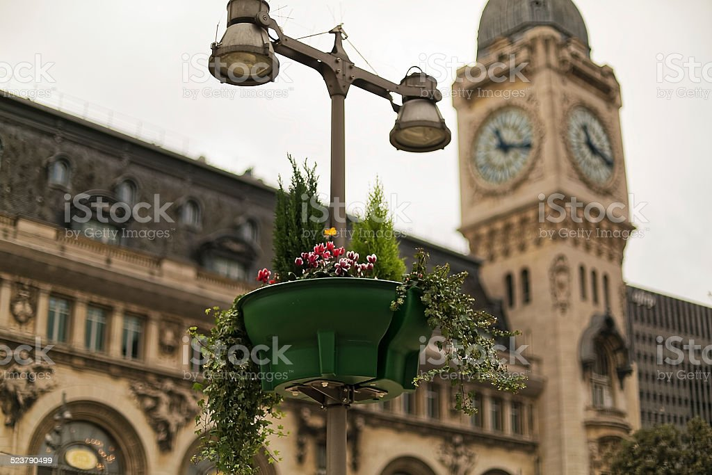 Clock, lamp and flower pot - Royalty-free Architecture Stock Photo