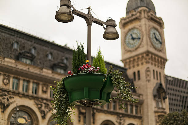 Clock, lamp and flower pot stock photo