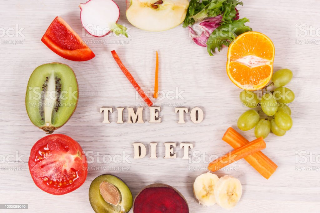 Clock made of fruits and vegetables containing minerals, time to diet concept stock photo
