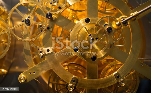 Golden clock mechanism close-up.