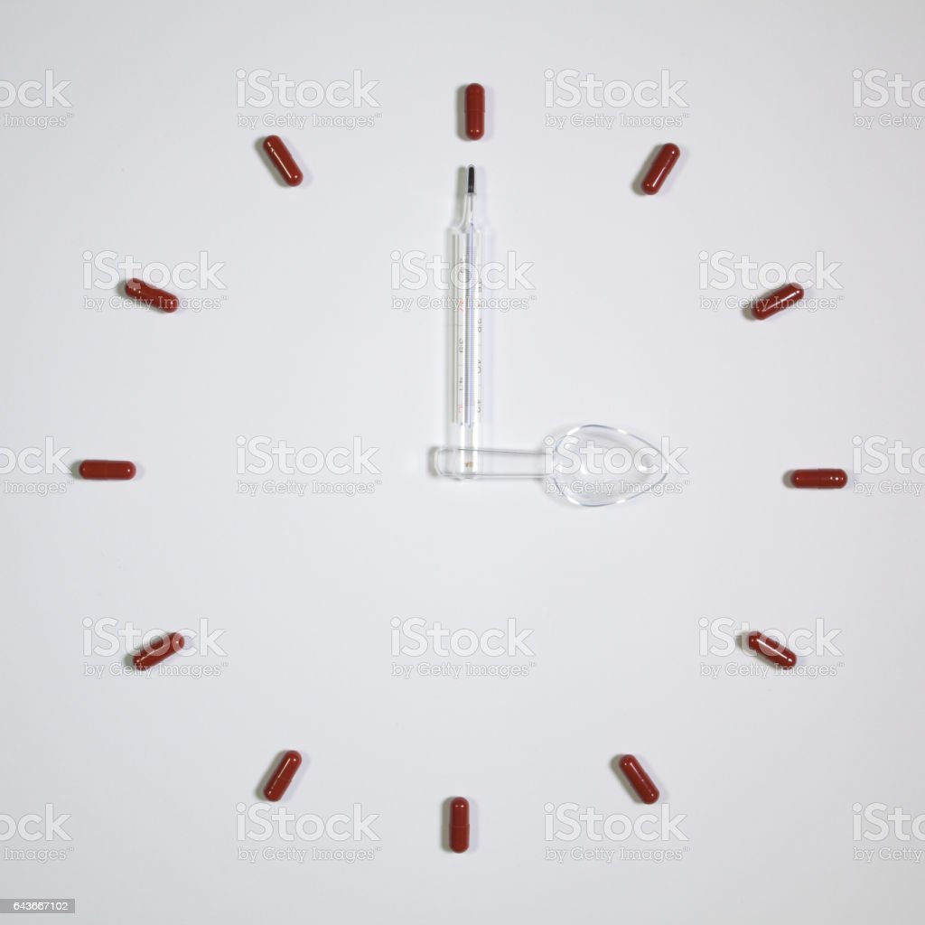 Clock of twelve pills stock photo