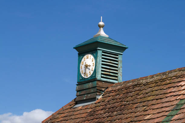 Clock on a roof stock photo