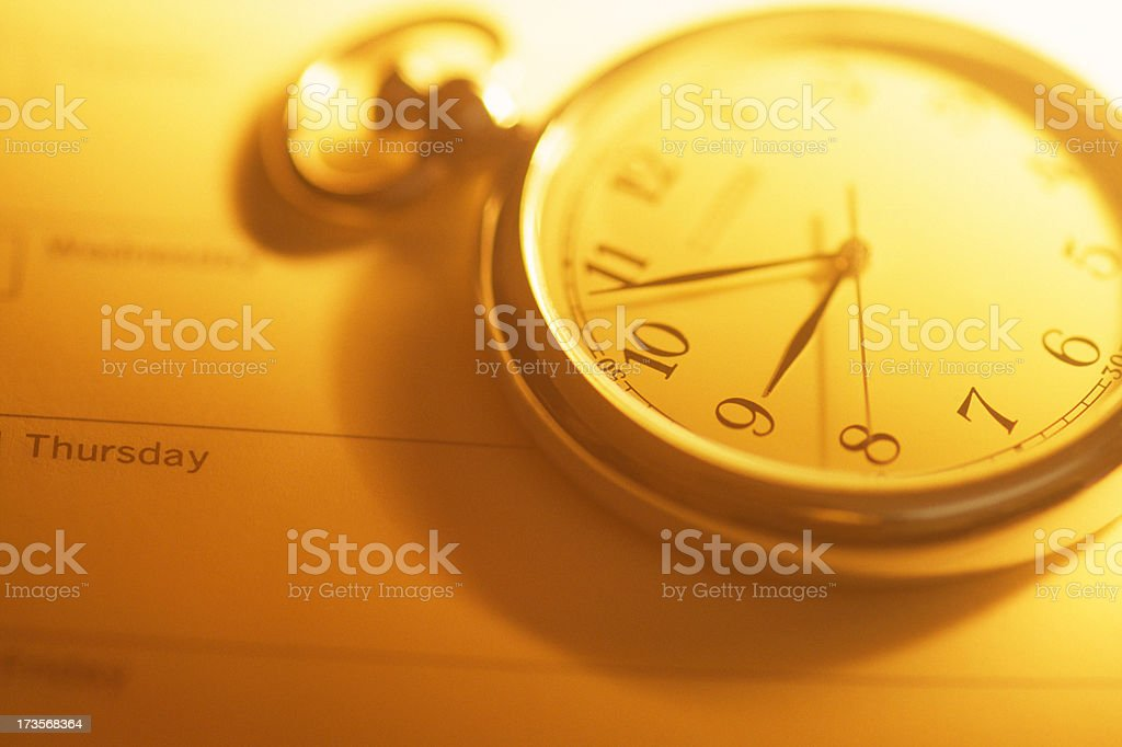 Clock on agenda stock photo