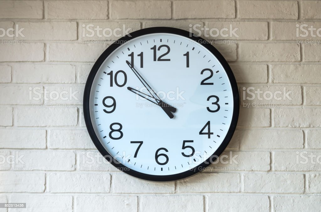 Clock on brick wall stock photo