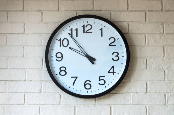 Clock on brick wall stock photo