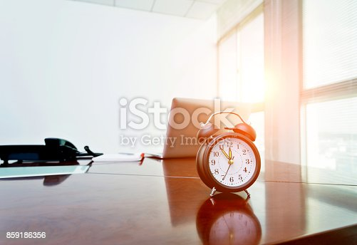 istock A clock on office table 859186356