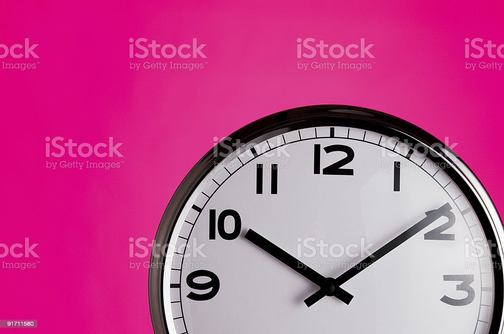 Clock on pink detail royalty-free stock photo
