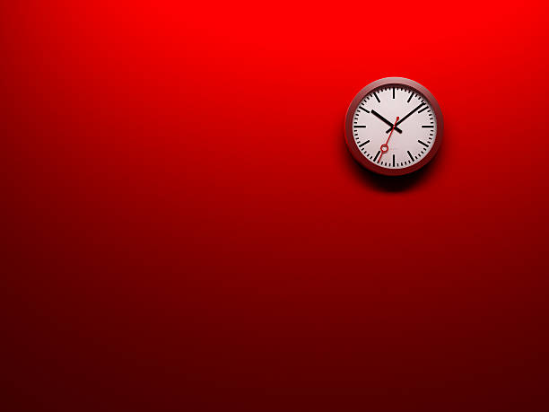 ... Clock on red wall stock photo  Clock stock photo  A ...