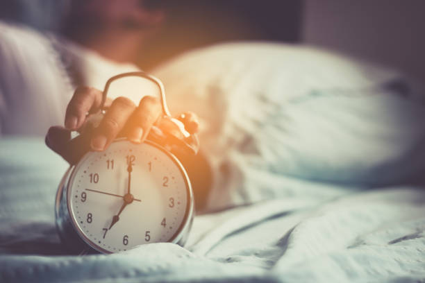 clock on the bed in the morning. - alarm stock pictures, royalty-free photos & images
