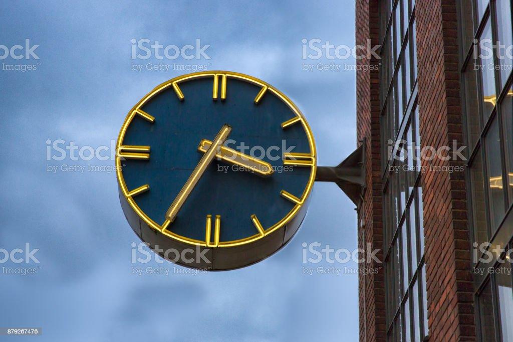Clock on the building facade. stock photo
