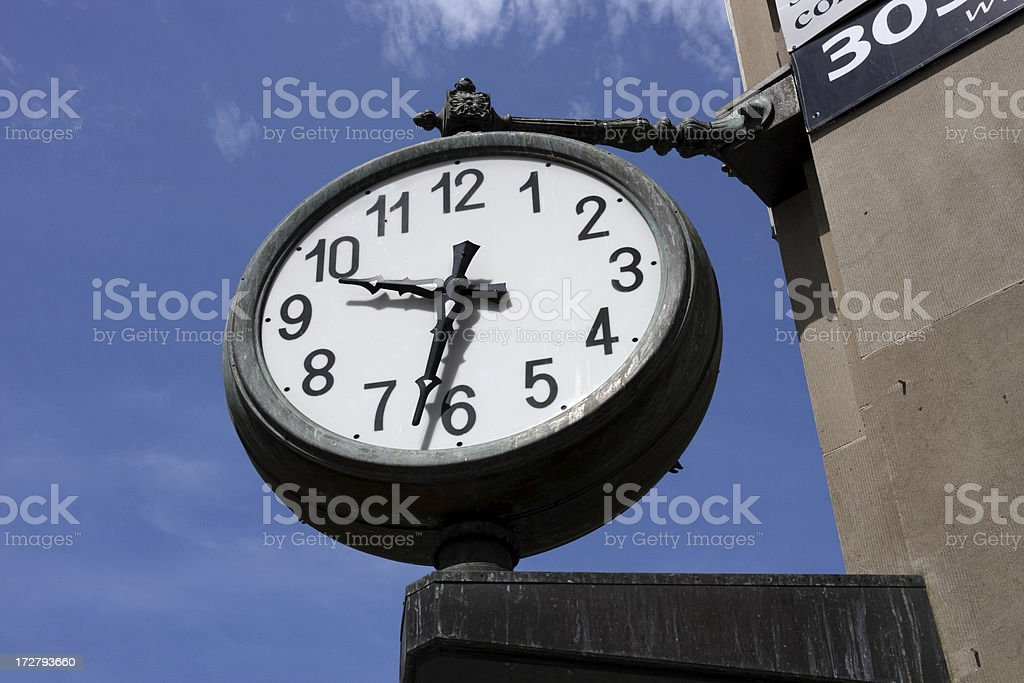 Clock on the corner royalty-free stock photo