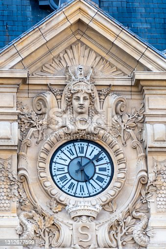 Detail of the facade and clock of the town hall of Suresnes, France. Suresnes is a town of the department of Hauts-de-Seine, located west of Paris