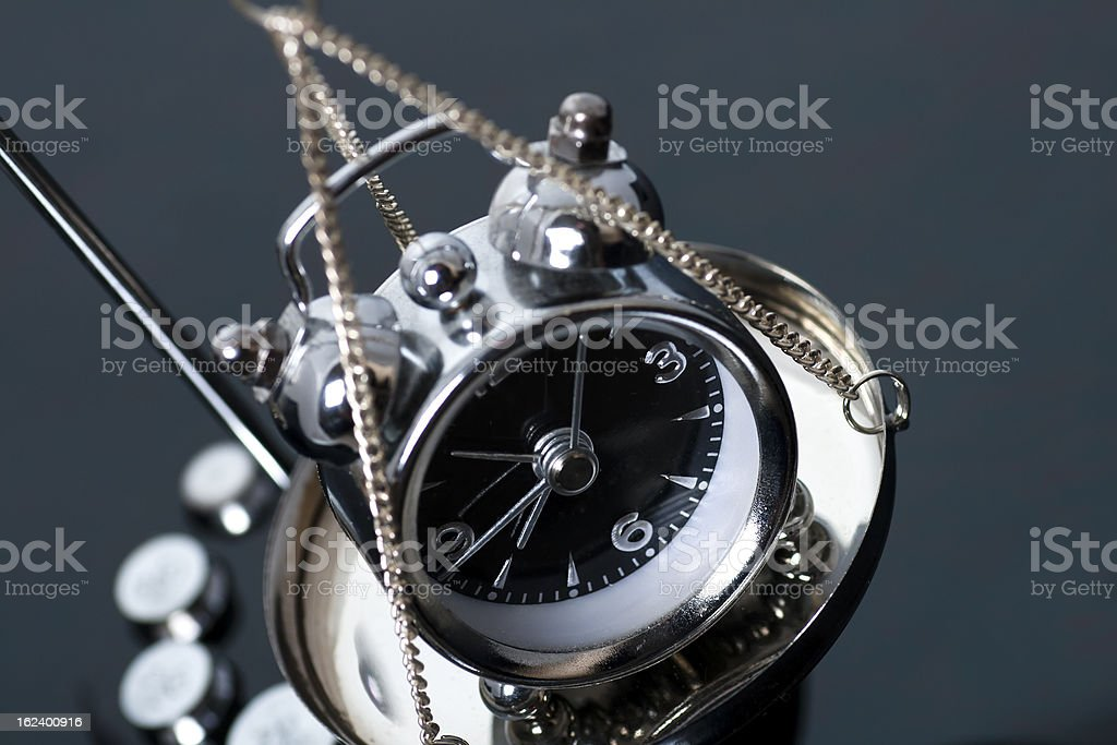 Clock on the scales royalty-free stock photo