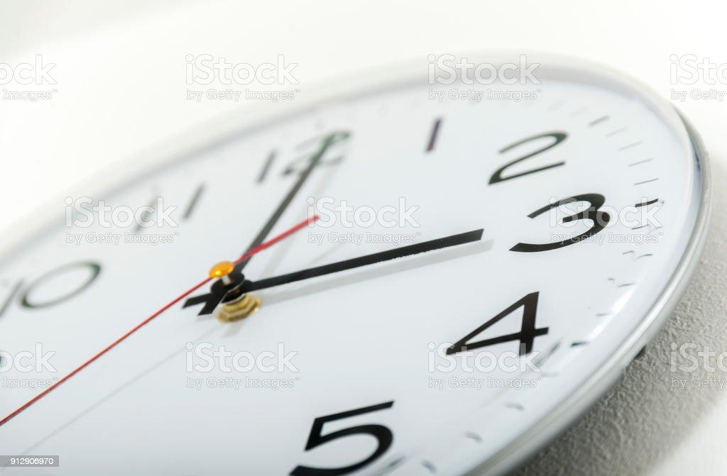 Clock on the white wall. Three o'clock. stock photo