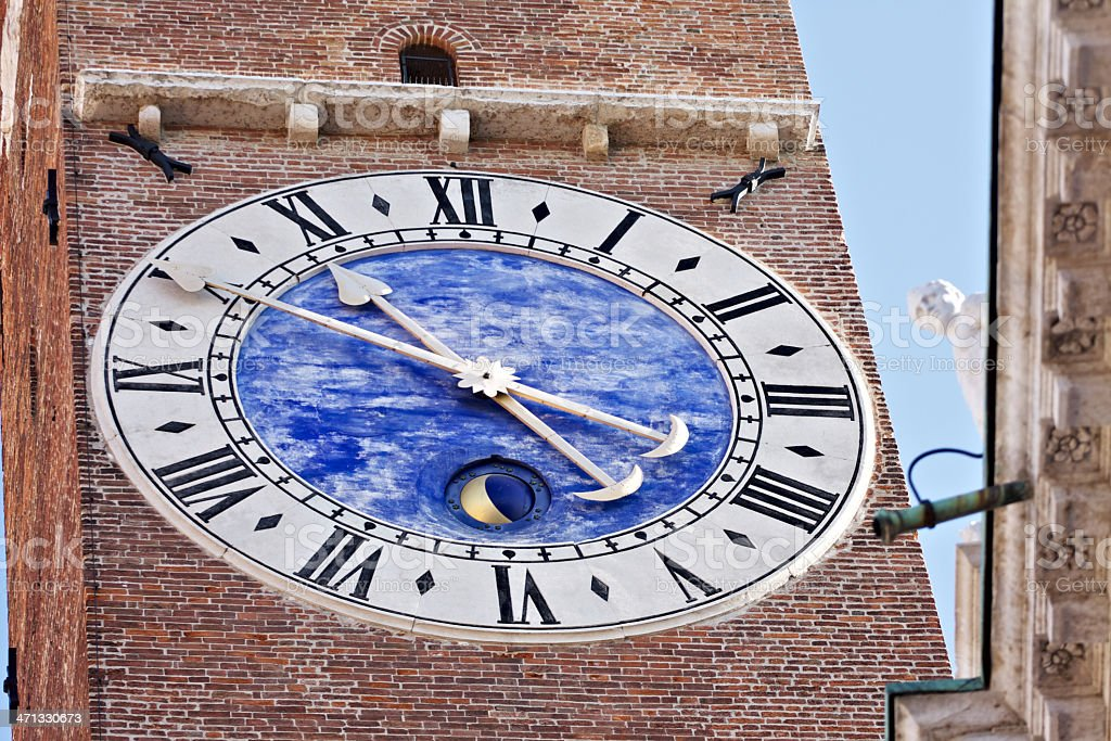 Clock on Tower Bissara next to Palladian Basilica in Vicenza. stock photo