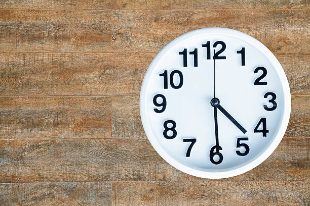 clock on wood background - number 30 stock photos and pictures