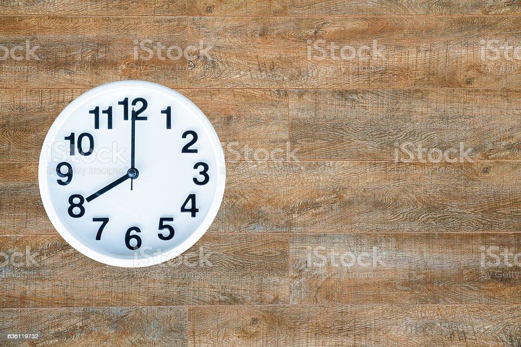 Clock on wood background stock photo
