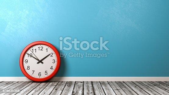 istock Clock on Wooden Floor Against Wall 876635068