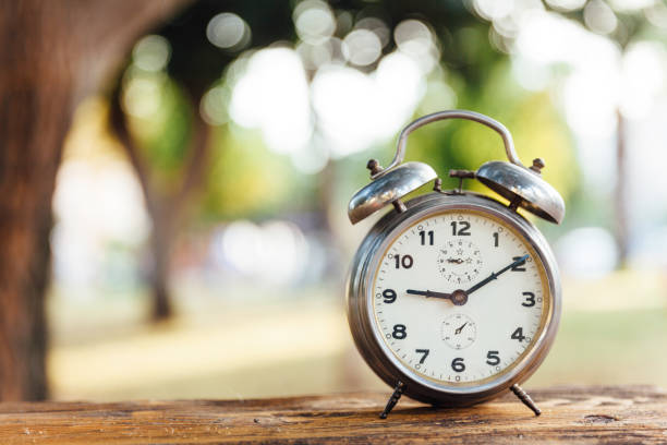 Clock outdoors Clock outdoors daylight savings stock pictures, royalty-free photos & images