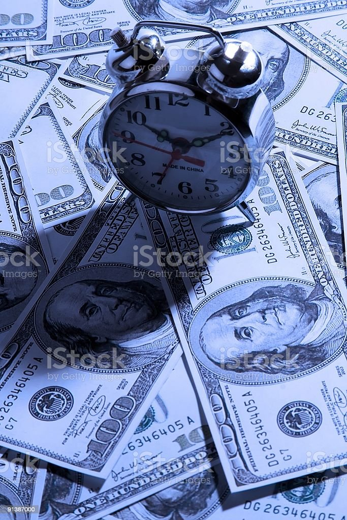 Clock Over Money royalty-free stock photo