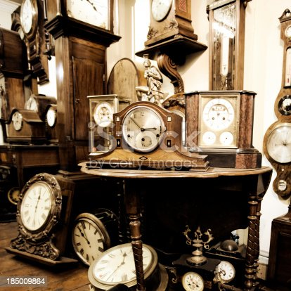 A shop filled with many clocks
