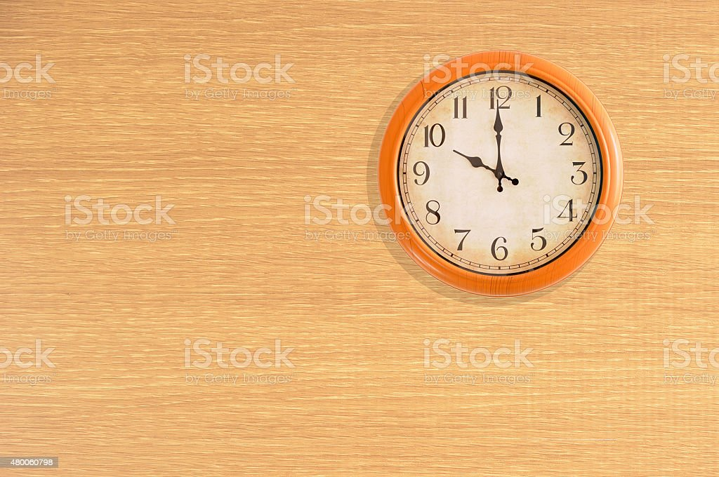Clock showing 10 o'clock on a wooden wall stock photo