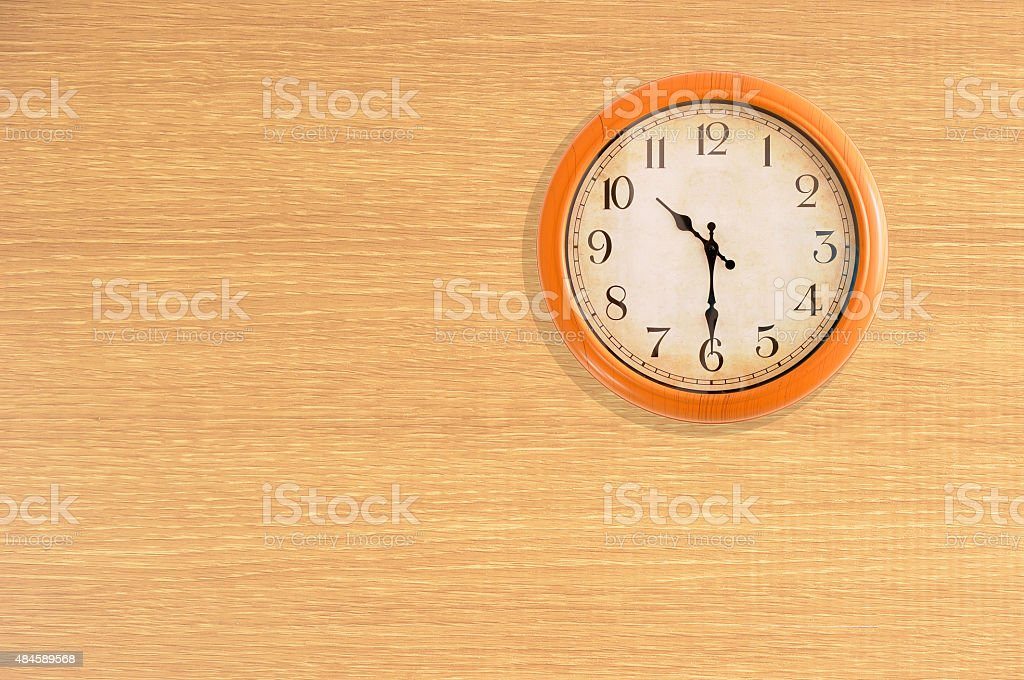 Clock showing 10:30 o'clock on a wooden wall stock photo