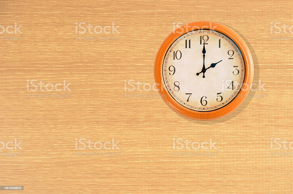Clock showing 2 o'clock on a wooden wall stock photo